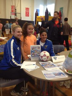 A fan poses with some of your Breakers players at the Healthy Kids Day clinic at the Oak Square YMCA in Brighton on April 26, 2014 #bostonbreakers #repin #comment