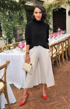 Aurora Perrineau in white culottes and slouchy black sweater.