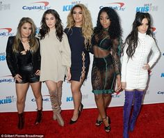 Joined in the fun: Fifth Harmony put their best feet forward as they posed for photos wear...