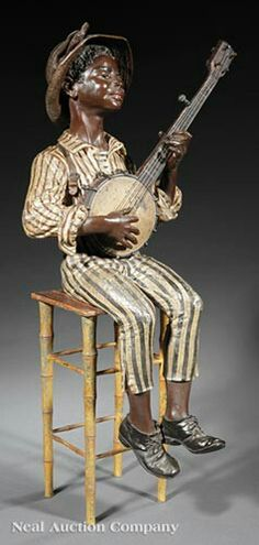 "Fine and Large Continental Cold-Painted Metal Figure of a Banjo Player, c. 1900, based on models by Emile Guillemin (French, 1841-1907) and Friedrich Goldscheider (Austrian, 1845-1897), modeled seated on a ""bamboo"" stool, indistinctly inscribed on top of stool, h. 31 in., w. 15 1/2 in., d. 13 1/4 in."