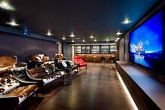 Home Theater with mini bar....my dream room!