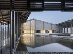 chinese practice original design studio recently completed the fan zeng art gallery in nantong, a structure used to exhibit, research, and collect the calligraphy, paintings, and poetry of mater fan zeng. the design takes base in the traditional concept of the chinese courtyard but re-interprets this notion through a contemporary context, re-establishing meaning and purpose of the vernacular in modern contexts.