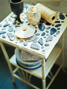 Quick and dirty stone mosaic table. Maybe I could do this with one of those old stools outside.