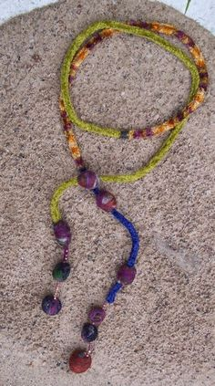 """Colar feito com o tricotin- Collana tricotin con perle giganti- Lariah style, spool knit chenille rayon cord, felt wool pearls, extremities of wool felt beads and japanese cube beads strung on linen. 62""""inches long"""