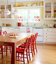 If you don't want to dish out the cash on a retro fridge or oven, add splashes of color throughout the room. Here, the yellow paint job instantly makes the room more upbeat, and the classic red hue makes an appearance on the cabinet knobs, chairs and hood. The retro look is completed with mint green countertops. The old-fashioned pendant lights shine, too.