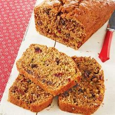 This zucchini bread is loaded with goodies like cinnamon, ginger, pecans, cranberries, coconut, and chocolate.