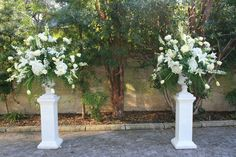 Unique Wedding Ceremony Flower Arrangements With The Ceremony Were Two Large And Lush All White Floral Arrangements Wedding Ceremony Ideas, Wedding Ceremonies, Altar Flowers, Church Flowers, Aisle Flowers, White Floral Arrangements, Wedding Flower Arrangements, Wedding Pillars, Blue Wedding Flowers