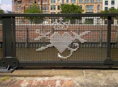 Cross Stitch Street Art – Embroidered Art Taken To The Next Level - Bored Art Cross Stitching, Cross Stitch Embroidery, Cross Stitch Patterns, Diy Embroidery, Embroidery Patterns, Yarn Bombing, Guerilla Knitting, Front Yard Fence, Low Fence