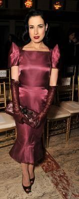 Who made Dita Von Teese's purple short sleeve dress? Dress – Zac Posen