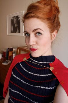 Lovely up do and sweater outfit.