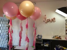"Preparing for our photo shoot! Soft romantic tones - lovely for an engagement or wedding incorporating warm pastel tones. Balloons in Blush, Light Pink and Rose with tassels in a mix of peach, white, light and dark pink. Also features ""love"" script balloon to finish the overall look."