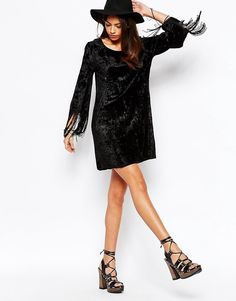 Buy it now. Fallen Star Crushed Velvet Swing Dress with Fringe Sleeve - Black. Evening dress by Fallen Star, Crushed velvet, Scoop neckline, Fringing to sleeves, Loose fit � falls loosely over the body, Dry clean, 100% Viscose, Our model wears a UK 8/EU 36/US 4 and is 173 cm/5'8 tall. ABOUT FALLEN STAR Fallen Star translates its romantic and flirtatious nature into a feminine, boho collection. Floral prints, delicate embroidery and embellishment channel the romance and nostalgia of bygone…