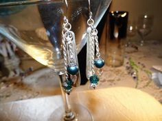 Teal Swarovski Crystal Solid Silver Spoon Stem Dangle Earrings . Silver Plated chain and finding.
