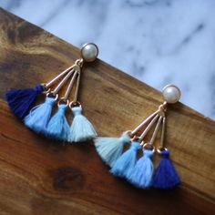 Blue and turquoise tassel earrings. Pearl accent. Post back. 50% of all net proceeds donated to animal rescue charities.