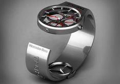 TAG-Heuer Grand Carrera Calibre 36 RS Caliper Chronograph'dan esinlenerek Macar tasarımcı Peter Vardai tarafından tasarlanan saat, F1 araçları tasarımının ruhunu saat dünyasına başarıyla taşımış. F1 araçlarının mütemadiyen hafifletilmesini konu alan tasarım, esinlenildiği saatin mümkün olduğunca...