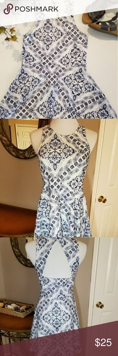 NWT Floral fit and flare dress by Aeropostale NWT floral fit and flare dress by Aeropostale.shades of blue on a white background and such a cute cutout in the back.  Fully lined. Aeropostale Dresses Midi