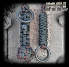 Black w/ thin red line Paracord Self Defense Lanyard (monkey fist) featuring steel ball and metal skull bead w/ welded rings