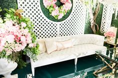 White furniture Revelry Event Designers wedding ideas green hedge wall
