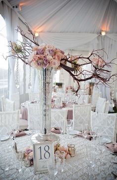 Pale pink suspended branch centerpiece - Beautiful Blooms--Cairnwood-Mansion-Hanging-Bling-Centerpiece #hanging #centerpiece #flowers