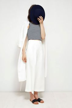 Black and white striped top with white pants.