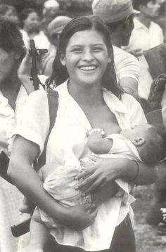 "Armed Sandinista Rebel Breastfeeding. ""Miliciana de Waswalito"" . Nicaragua, 1984"