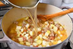 pouring chicken stock into soup pot with diced potatoes and Italian sausage Sausage Potatoes, Diced Potatoes, Stewed Potatoes, Chicken Sausage, Copycat Zuppa Toscana, Zuppa Toscana Soup, Butter Cream Sauce, Olive Garden Soups, Tuscan Soup