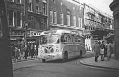 The construction of Woolworths on Castle Street in the 1960's, Shrewsbury, Shropshire. Vintage bus.