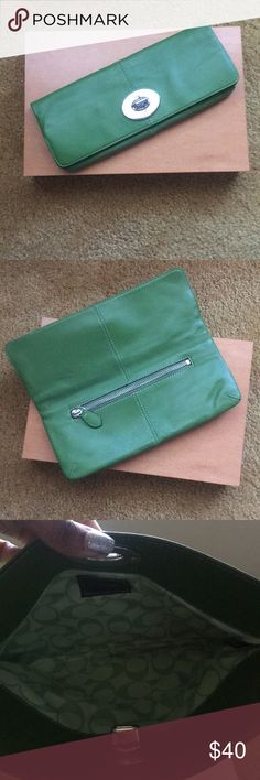 Authentic Leather Coach Clutch in Green Green Leather Coach Clutch in excellent condition outside of the ink mark. I will see if I can remove the ink mark (see pic). The purse has been worn twice. Coach Bags Clutches & Wristlets