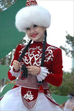 Kyrgyz girl in traditional dress.