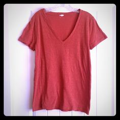J. Crew Orange V-Neck Tee This J. Crew orange v-neck tee is made for the woman who prefers to be understated in her beauty. Pair this tee with boyfriend jeans and some black flats, and you have a look that never goes out of style. ❤️ J. Crew Tops Tees - Short Sleeve