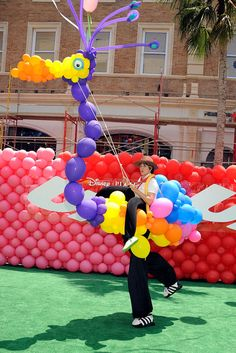 """TheSooziShow.com performing balloon """"Kevin"""" bird puppet on stilts as Atmosphere at the premiere of Disney Pixar's ''Up'' at the El Capitan Theatre on May 16, 2009 in Hollywood, California."""