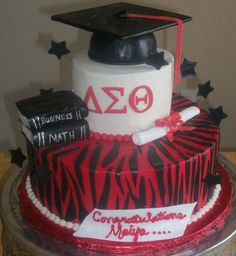Red black and white Delta and Zebra print graduation cake