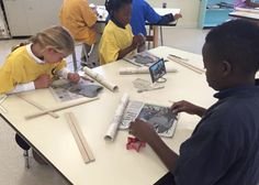 4th graders make their clay ornaments in Lower School art.