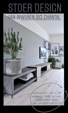Stoer industrieel TV meubel van beton op maat gemaakt met een schuifdeurtje van oud hout en een overzettafel van oud hout. Je vind dit TV meubel in onze webshop en in onze showroom. U kunt kiezen uit verschillende kleuren beton: grijs, antraciet, zwart en wit.
