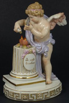 "Antique Meissen German porcelain cherub figure. Depicts a winged cherub pouring water over two burning hearts as they sit on a column. The saying ""Je Mets Le Calme"" can be seen on a plaque on the column. 19th century, 8.75 inches in height"