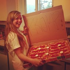 """Who doesn't love pizza? Ask your crush to prom by delivering a pizza to his house with """"PROM?"""" written inside the box. If you're creative try spelling it out with pepperonis."""