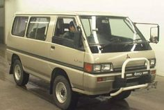This 1986 Mitsubishi Delica 4x4 is a Japanase market van imported under the DOT 25 year rule. Stock apart from big tires, it's said to benefit from a recent major service including timing belt, water pump, seals and more. We like the reconfigurable seating, working dual A/C and life-sized R.C.
