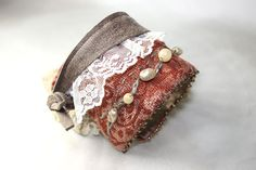 Items similar to Lace Leather and Pearls Textile Fabric Wrist Cuff Bracelet Salmon Rose on Etsy Fabric Bracelets, Fabric Necklace, Cuff Bracelets, Lace Jewelry, Fabric Jewelry, Dryad Costume, Cowgirl Outfits, Textile Fabrics, Leather And Lace