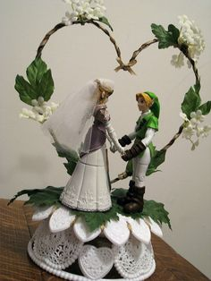 Zelda and Link wedding topper. I've decided (about five minutes ago) I'm going to have a Zelda themed wedding. (Mainly so I can wear those zelda shoes). Now I gots to find me a nerdy man!