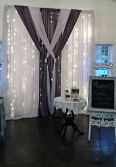 Ceremony, head table, cake and guest signing backdrops offered by Moments In Time Wedding & Event Rentals, 406.208.9549.
