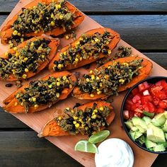 Dinner is served! Roasted sweet potatoes stuffed with lamb mince spiced with tumeric, ground cumin and ground coriander, fresh corn, black beans, carrots, zucchini and mushrooms. Served with fresh tomato, avocado and lime topped with plain @chobaniau yogurt.  #healthyeating #dinner #nutrition #raisingathletes #healthykids #healthyfamily #healthy #healthyliving #sweetpotato #athletefood #chobani #foodforathletes #feedfeed @thefeedfeed