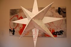 DIY hanging holiday stars to make with your kids. Really simple, and you can do it with a preschooler (they color, you fold + glue).