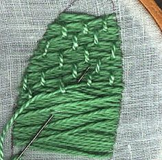 Stitches in Laid Work, Two More Methods- Brick Pattern for Tying Threads- Two more stitches from those which were originally reserved for embroidery on silk and velvet and are generally termed laid work. For a more comprehensive discussion, please see Plaited Stitch.