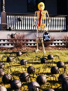 Embrace the spirit of Halloween in your front yard with this spider-filled bonanza: http://www.bhg.com/halloween/indoor-decorating/halloween-door-decor-28-great-ideas/?socsrc=bhgpin100614&page=16