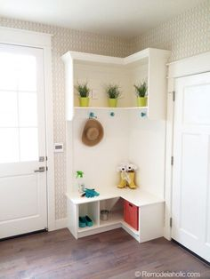 small corner mudroom. white with pops of color