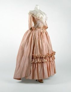 """French robe a l'anglaise dating 1785-1787    """"By mid-century [of the 18th century] the style was for the bust, veiled by lace or a sheer mull fichu, to emerge above the top line of the bodice.""""    metropolitan museum"""