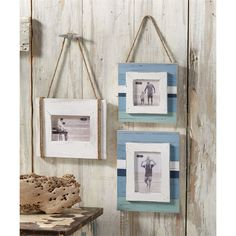 Distressed and planked beach blues frame hangs with jute rope.  Frame-on-frame…