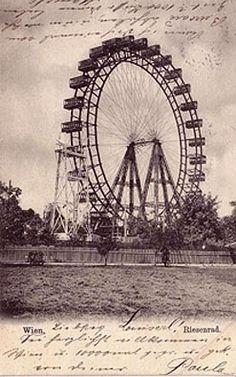 A whimsical black  white, vintage Ferris wheel photograph.