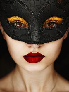 Black mask for a masquerade. Don't forget that your eye make up may be visible, and creating a stark contrast makes you that much more mysterious!