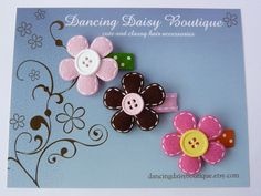 stitched felt flowers on baby snap clips - set of three. $8,99, via Etsy.